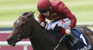 Ryan Moore riding US Navy Flag to win The Darley Dewhurst Stakes at Newmarket. Photograph: Alan Crowhurst/Getty Images