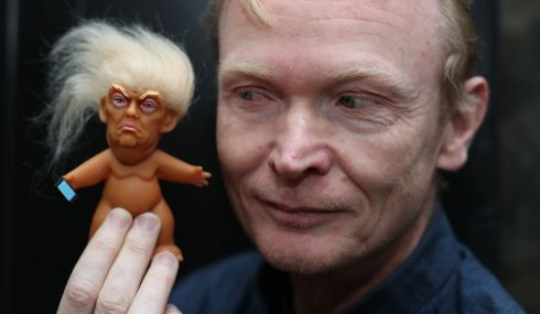LUNATIC FRINGE: Gallery owner Frank O'Dea with an imported Donald Trump troll doll. Photograph: Niall Carson/PA Wire