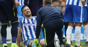 Brighton's Shane Duffy grimaces as he receives treatment on the pitch before being substituted during the Premier League match against Everton. Photograph: Dan Istitene/Getty Images