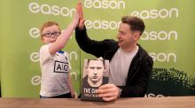 Philly McMahon high fives young fan Joe Ecock as he signed copies of The Choice