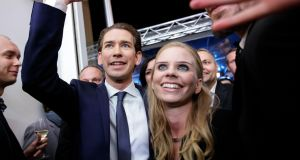 Sebastian Kurz, Austria's foreign minister and leader of the People's Party (OeVP), celebrates victory in Austria's general election with his  girlfriend, Susanne Thier, in Vienna. Photograph: Lisi Niesner/Bloomberg