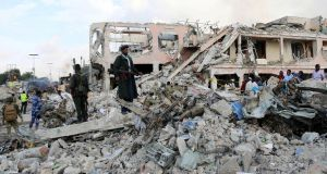 Somali government forces on Sunday secure the scene of an explosion in  the Hodan district of Mogadishu. Photograph: Feisal Omar/Reuters