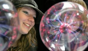 Rebecca Kelly, left, and Breda Kenny, both from Castlecomer Community School, Co Kilkenny,  at the Trinity College Open Day with a Lightening Ball which contains a mixture of gases that generate electromagnetic waves