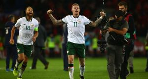 Ireland's James McClean celebrates with David Meyler after the final whistle of their World Cup qualifier against Wales. Photo: Geoff Caddick/Getty Images
