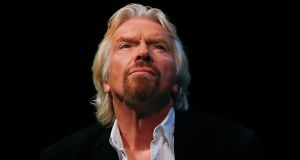 Richard Branson: while his behaviour is open and public and there is no suggestion he seeks to bully women, it does create images of beautiful young women in a working environment being bodily manhandled. Photograph: Shannon Stapleton/Reuters