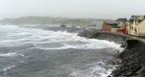 Hurricane  Ophelia batters Lahinch village in Co Clare: Ireland is not known for meeting its obligations on greenhouse gas emission reductions. Photograph: Aidan Crawley/EPA
