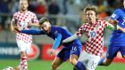 Croatia midfielder Luka Modric challenges  Finland forward Simon Skrabb during the qualifier in Rijeka at the start of October. Photograph: Antonio Bat/EPA