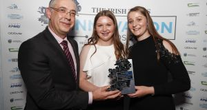 Gearoid Mooney, Enterprise Ireland, presenting the award for New Frontiers to Annie Madden and Kate Madden from FenuHealth.com. Photograph: Conor McCabe Photography