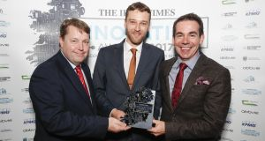 Ciarán Hancock,  Irish Times business editor, presenting the award for Energy and Environment to Dermot Hughes and Michael Murray from NVP Energy. Photograph:  Conor McCabe Photography