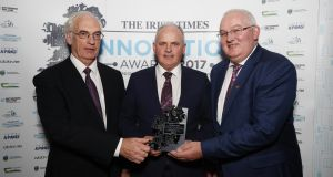 Dermot McCarthy, Teagasc, presenting the award for Agrifood to Jack O'Connor and Declan O'Connor from BHSL. Photograoh: Conor McCabe Photography