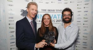 Mike O'Neill, UCD Smurfit School, presenting the award for IT  and Telecommunications to Catherine Downes and Andrés Macías from Usheru. Photograph:  Conor McCabe Photography