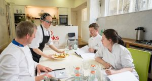 Bronagh Rogers, who has made it to the final six in the Euro-Toques Young Chef of the Year competition, presenting her semi-final dish to judges Graham Neville, Gareth Mullins and Danni Barry
