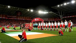 The teams line up for the anthem ahead of the Wales v Republic of Ireland qualifier at Cardiff City Stadium. Photograph:   Ryan Byrne/Inpho