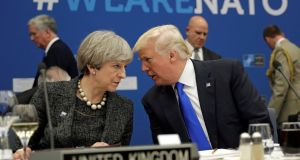 "British prime minister Theresa May talks to US president Donald Trump:  ""Thank God for Donald, that he's reminded us how important it is to be together as Europeans,"" Dr Nathalie Tocci said at the Institute of International and European Affairs.  Photograph: Matt Dunham/Reuters"