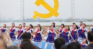 Performers prepare for the 19th Communist Party Congress in Huaibei in China's eastern Anhui province. Photograph:  AFP/Getty Images