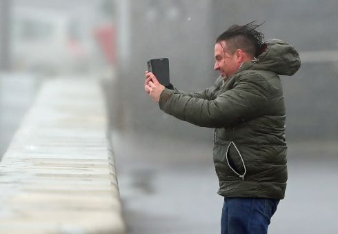 A man take selfies in waves and high wind at Lahinch in County Clare .  Photograph: Niall Carson/PA