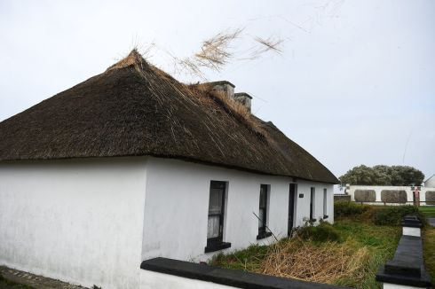 The roof of a thatched cottage starts to blow off as storm Ophelia hits the County Clare village of Spanish Point.  Photograph: Clodagh Kilcoyne / Reuters