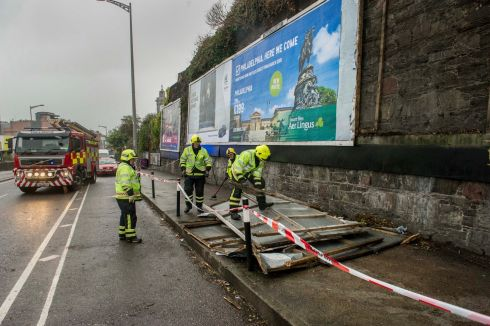 Advertising hoarding is ripped off during Storm Ophelia near Kent Station Cork city.  Photograph: Daragh Mc Sweeney/Provision