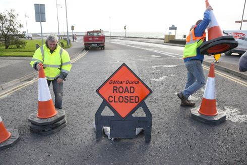 Galway City Council workers closing roads on the Salthill Promenade on Monday morning.  Photograph: Joe O'Shaughnessy