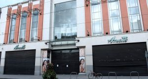 Shutters remain closed at Arnotts department store in Dublin as Hurricane Ophelia hits  Ireland with gusts of up to 128km/h. Photograph:  Caroline Quinn/PA Wire