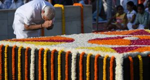 Indian prime minister Narendra Modi pays tribute on the 148th anniversary of Mahatma Gandhi's birth , on October 2nd, 2017, at Rajghat in New Delhi. Photograph: Prakash Singh/AFP/Getty Images