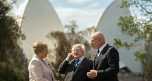 President Michael Higgins (centre) talks with New South Wales' governor David Hurley(right) as they walk in the garden with TánaisteFrances Fitzgerald at Government House in Sydney on October 17th, 2017. Photograph: AFP