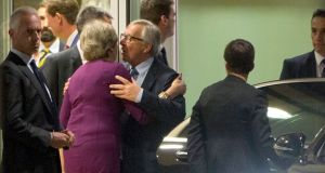 European Commission president Jean-Claude Juncker embraces British prime minister Theresa May after a meeting at EU headquarters in Brussels on Monday. Photograph: Virginia Mayo/AP