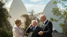 President Michael D Higgins talks with New South Wales' Governor David Hurley as they walk in the garden with Frances Fitzgerald at Government House in Sydney. Photograph: Steve Christo/Getty Images