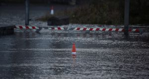A traffic cone is seen in a flooded car park during Storm Ophelia in Galway on Monday. Photograph: Reuters/Clodagh Kilcoyne