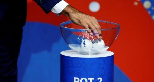 Former Spanish player Fernando Hierro shuffles the balls during the draw. Photograph: Arnd Wiegmann/Reuters