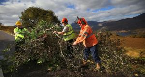 The big Clear up after Ophelia - Tree Surgeon, Ger Brosnan, centre, with staff from Kerry County Council, Donal O'Connell, left and John Lehane, clearing and cutting trees along the Moll's Gap Road, Killarney to Kenmare, which was closed on Tuesday. Photograph: Valerie O'Sullivan