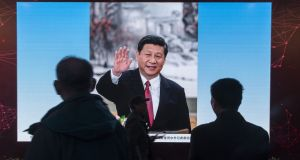 Attendees look at a slideshow of Chinese president Xi Jinping at the Five Years of Sheer Endeavour show at the Beijing Exhibition Centre as he is poised to become the most powerful figure in Chinese politics since Mao Zedong. Photograph: Qilai Shen/Bloomberg
