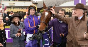Mrs Maureen Mullins, jockey  Patrick Mullins and Willie Mullins after  Wicklow Brave's victory in the Betdaq Punchestown Champion  at Punchestown. Photograph: Cyril Byrne/Photograph
