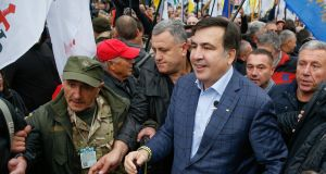 "Former Georgian president Mikheil Saakashvili with  supporters in front of parliament in Kiev: ""Poroshenko needs to think about leaving his post . . . That is not my ultimatum, it is my advice."" Photograph: Sergey Dolzhenko/EPA"