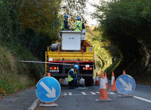 ESB crew workers at Glenamuck Road restoring services on Tuesday morning following Ophelia storm damage.  Photograph: Cyril Byrne/The Irish Times.
