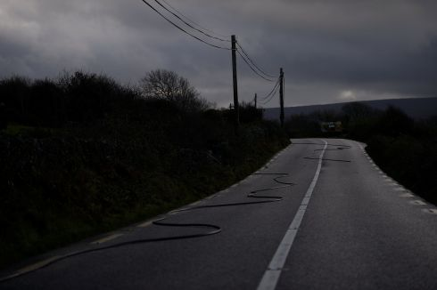 A fallen live electricity wire on the road during Storm Ophelia in Ballyvaughan, Co Clare.  Photograph: Clodagh Kilcoyne / Reuters
