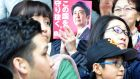 A pamphlet featuring Shinzo Abe at  a campaign rally in Sapporo, Hokkaido, on Sunday, October 15th: Mr Abe looks set to retain his coalition's dominant position in parliament. Photograph: Eiji Ohashi/Bloomberg