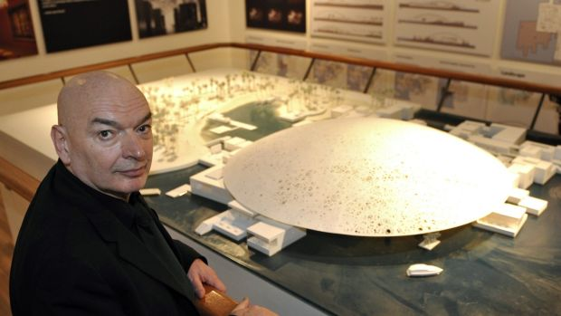 French architect Jean Nouvel with a model of the Abu Dhabi Louvre museum. Photograph: Philippe Wojazer/AFP/Getty Images