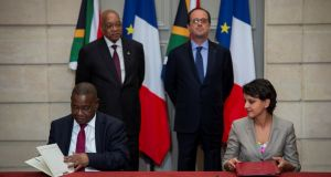 South Africa's then education minister Blade Nzimande signs an agreement in Paris alongside his French counterpart, Najat Vallaud-Belkacem, while presidents Jacob Zuma and François Hollande look on, in July 2016. Photograph: Jeremy Lempin/Reuters