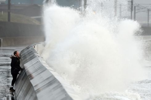 STORM OPHELIA: Waves crash over the breakwater as Storm Ophelia hits Saltcoats in Scotland. Photograph: Andy Buchanan/AFP/Getty Images
