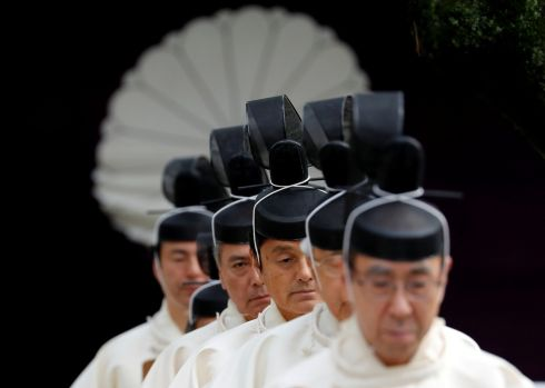 AUTUMN RITUAL: Japanese Shinto priests attend a ritual during an autumn festival at Yasukuni Shrine in Tokyo. Photograph: Kim Kyung-hoon/Reuters
