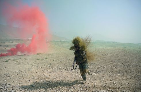 MILITARY TRAINING: An Afghan National Army commando takes part in a military exercise at the Kabul Military Training Centre. Photograph: Shah Marai/AFP/Getty Images
