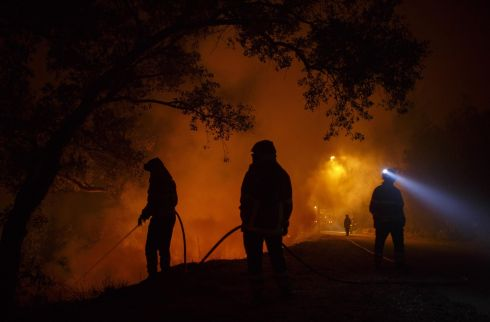 PORTUGAL WILDFIRE: Firefighters battle a forest wildfire next to Vilarinho, in Coimbra region, Portugal. Photograph: Pablo Blazquez Dominguez/Getty Images