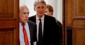 "OECD secretary-general Ángel Gurría and Britain's chancellor   Philip Hammond: the Paris-based think tank was accused of being ""a leading advocate of Brexit pessimism"". Photograph: Matt Dunham/PA Wire"
