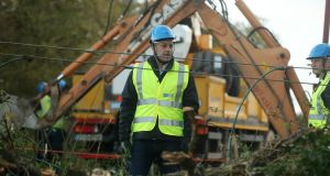 Taoiseach Leo Varadkar meets ESB Network workers in Kilcock, Co Kildare,  on Tuesday as they clear fallen power lines after Storm Ophelia. Photograph: Niall Carson/PA Wire