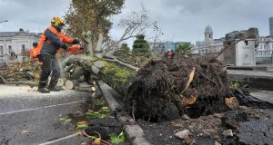 "Cork City Council workers clean up after Storm Ophelia: ""The main damage and disruption was caused by trees and telegraph poles bringing down power lines leading to power outages,"" says David Spillett of Cork City Fire Brigade. Photograph:  Daragh McSweeney/Provision"