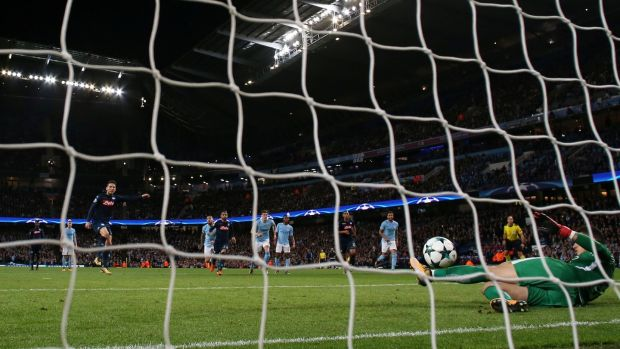 S Manchester City's Ederson saves a penalty from Napoli's Dries Mertena. Photograph: Jason Cairnduff/Reuters