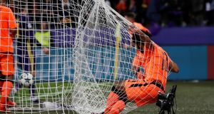 Liverpool's Mohamed Salah falls into the net after scoring their fourth goal. Photograph: Paul Childs/Reuters