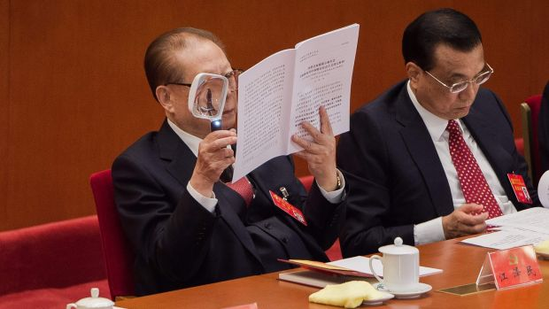 China's former president Jiang Zemin reads Xi Jinping's speech with a magnifying glass. Photograph: Nicolas Asfouri/AFP/Getty Images