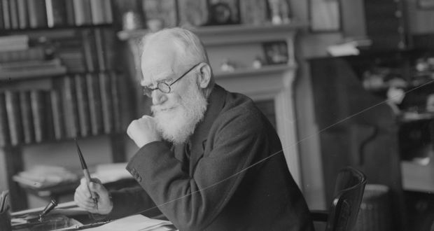 December 1928: Irish dramatist, essayist, critic and pamphleteer George Bernard Shaw (1856 - 1950) working at his desk. Photograph: Fox Photos/Getty Images